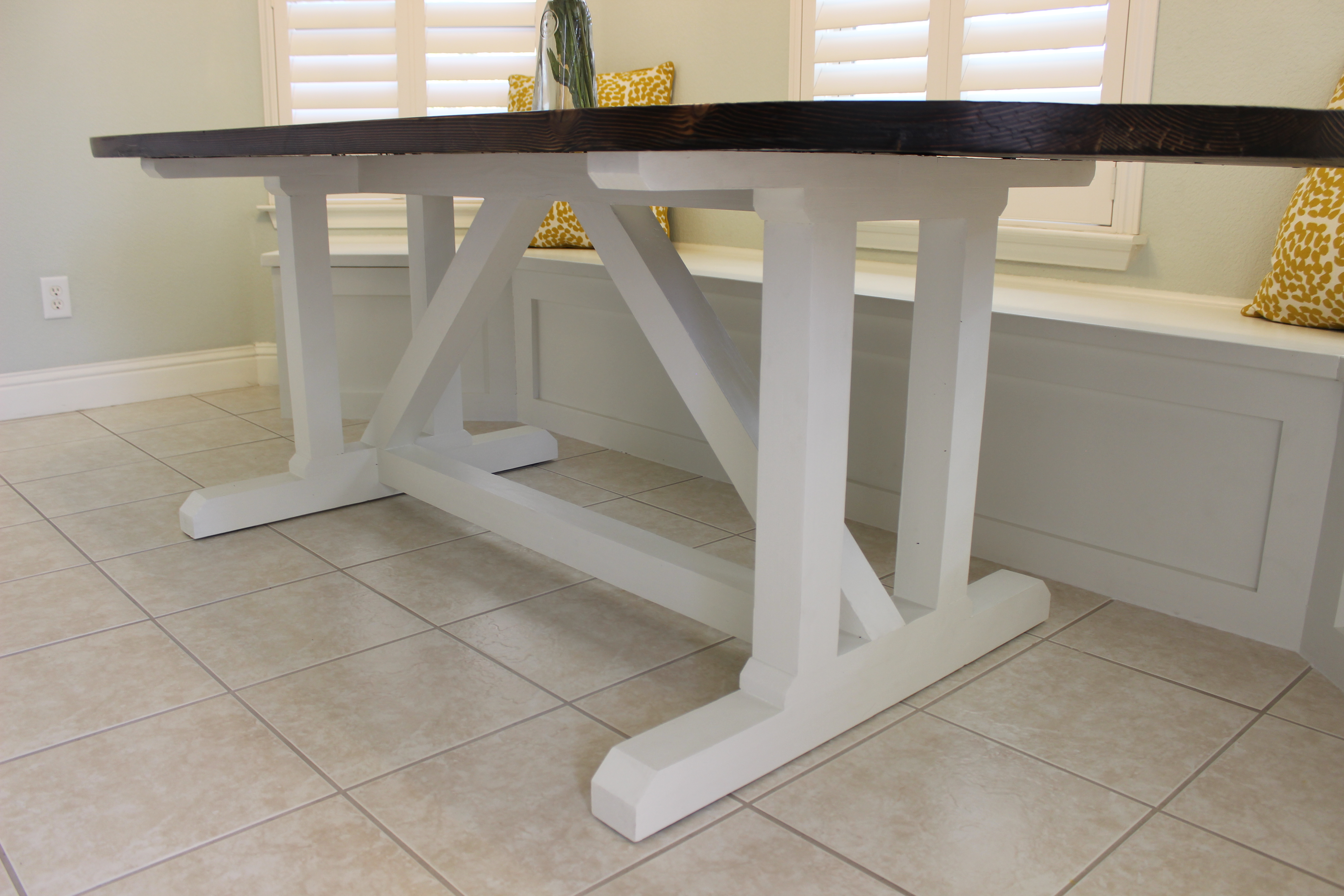angled view of finished racetrack-shaped dining table