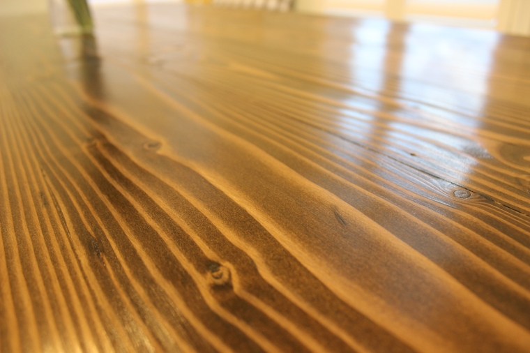 Up-close shot of wood grain of dining table