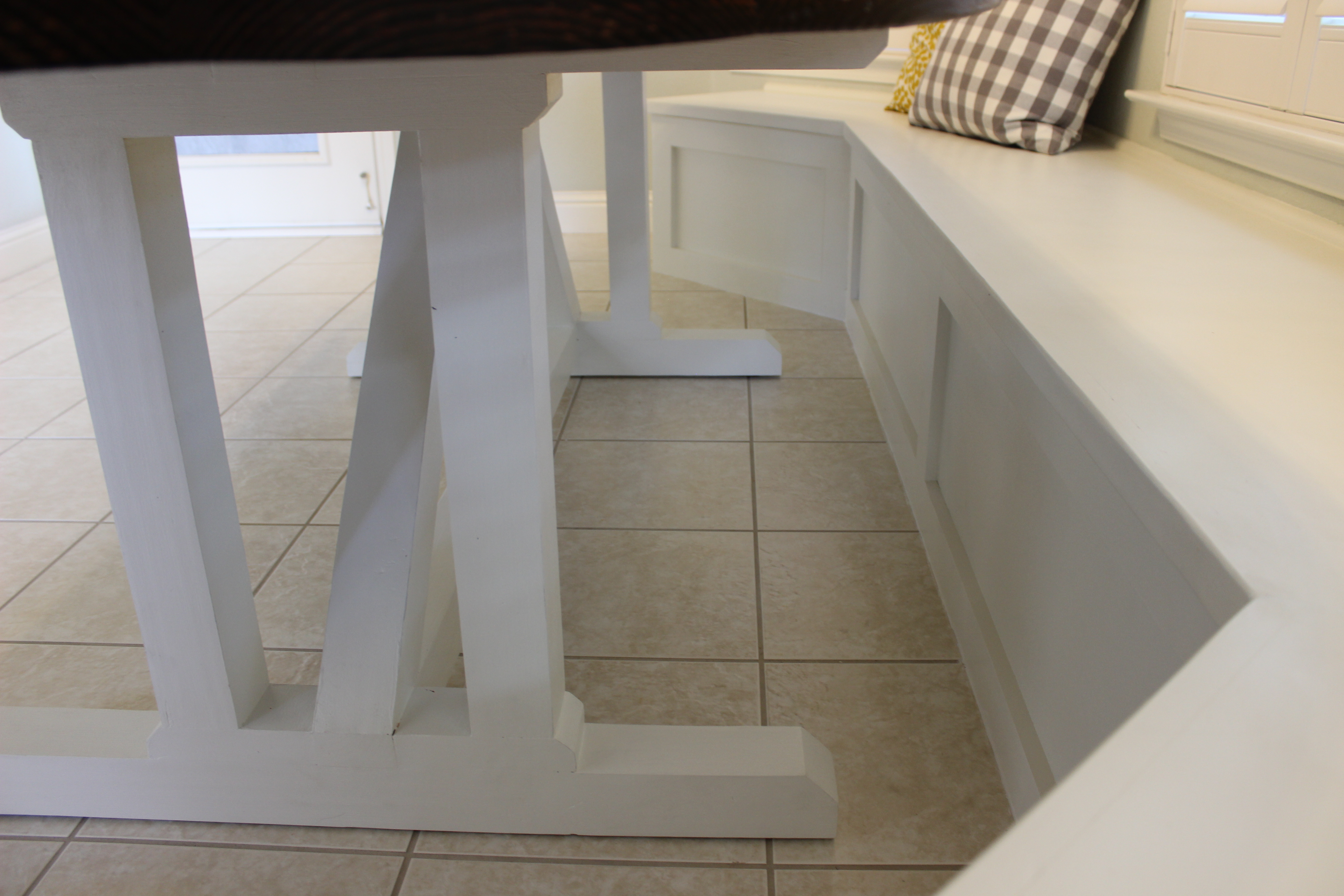 view of finished table base next to banquette seating
