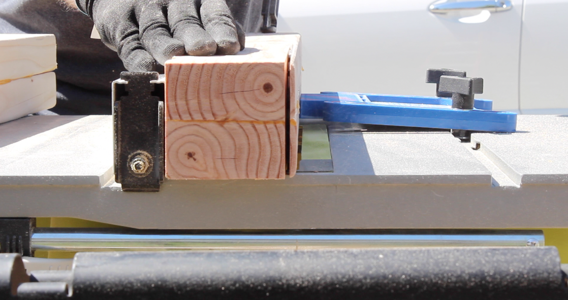 Trimming the table legs to their final width on a table saw