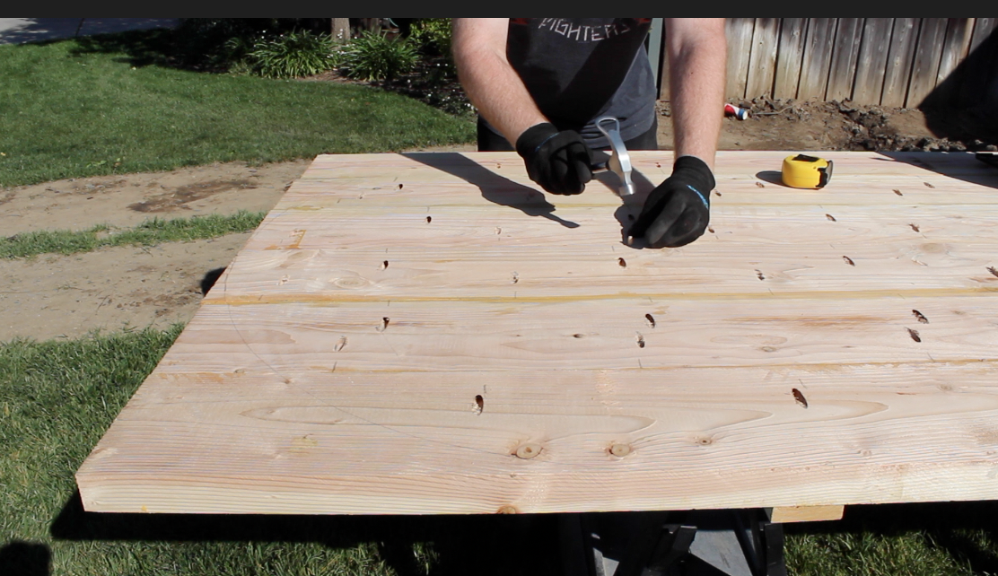 putting a nail in the bottom of the table top for the saw jig
