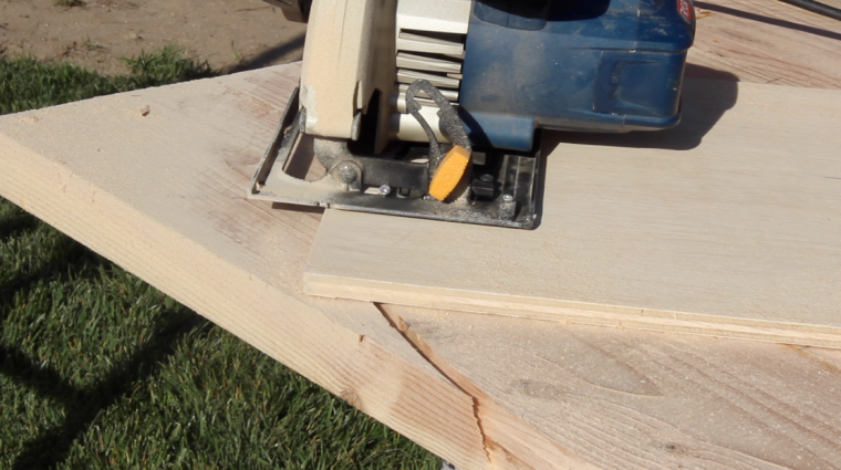 Using a circular saw to cut the rounded ends of the table top