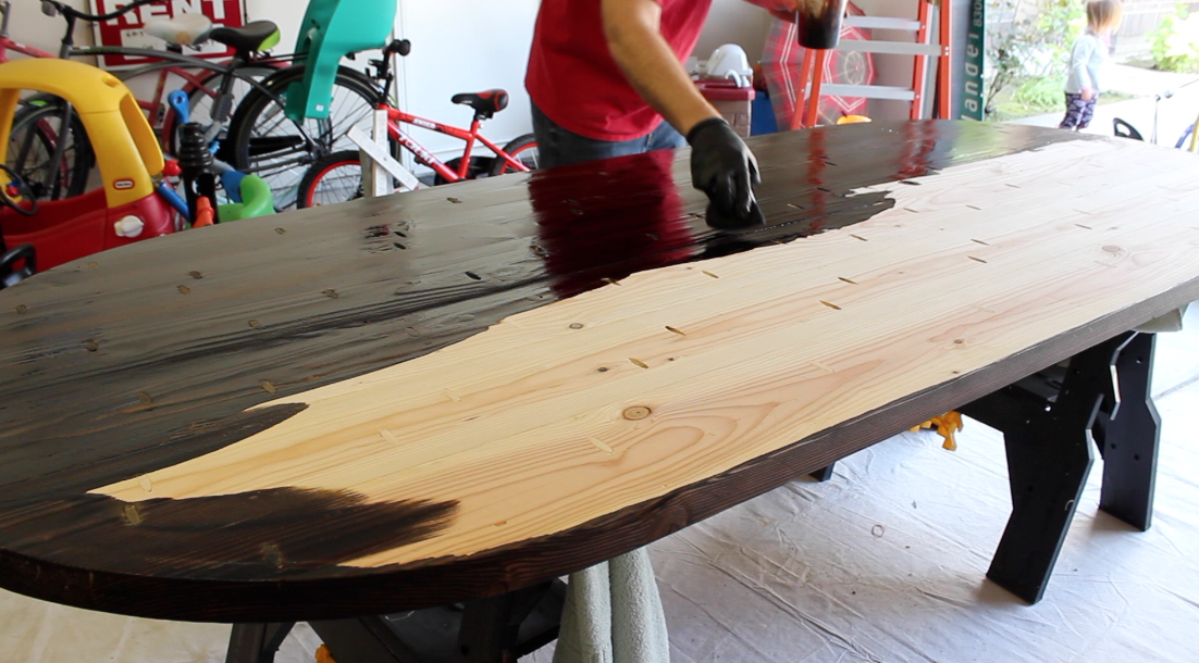 Applying walnut stain to bare wood table top