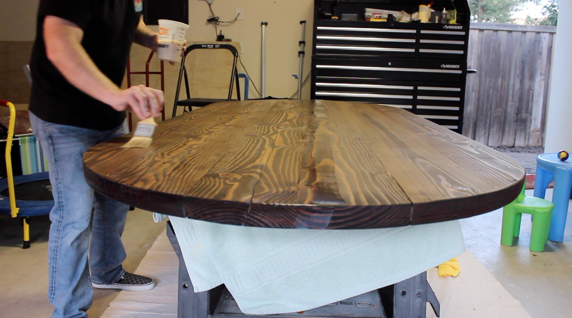 Applying polyurethane finish to wood table top