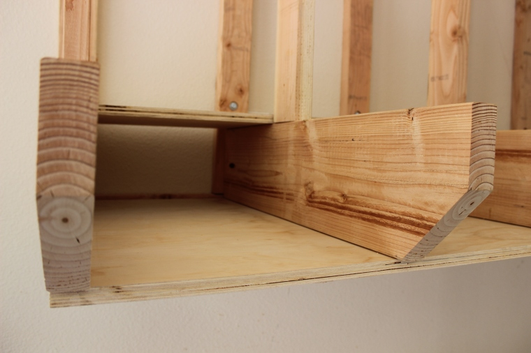 small cubbies in lumber rack for short boards