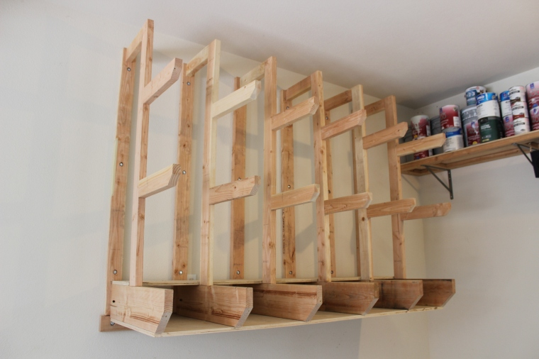 wall-mount lumber rack in garage