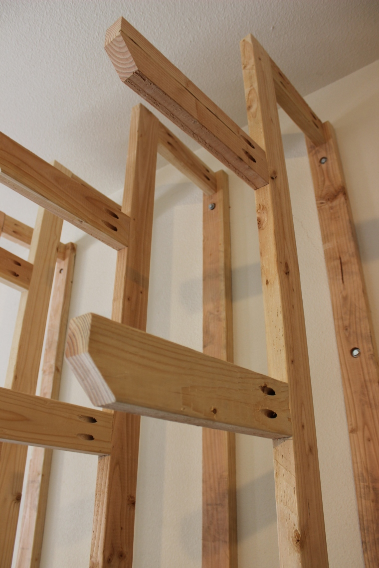 arms of lumber rack attached by pocket screws