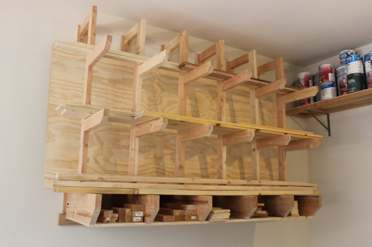 wall-mount lumber rack full of wood