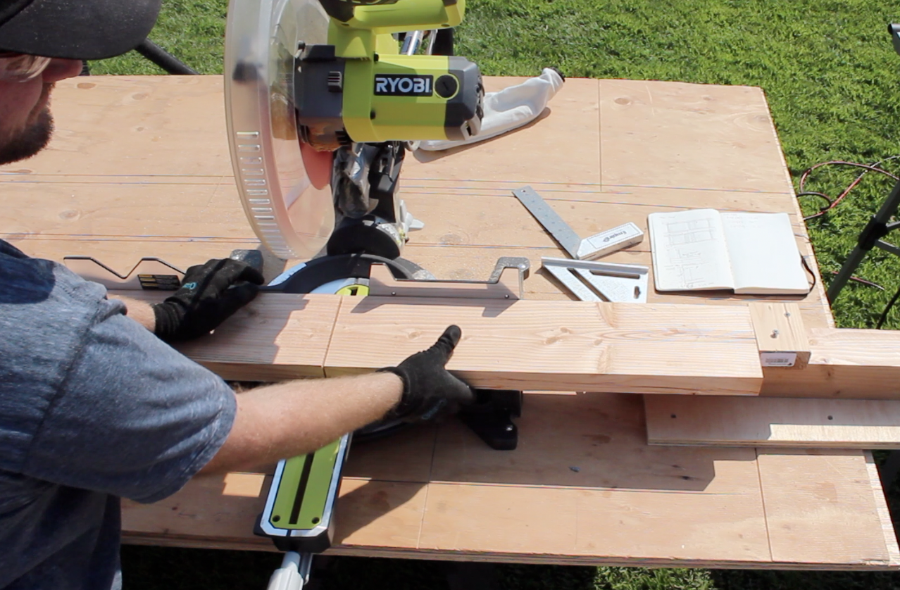 Cutting legs of the workbench with a miter saw