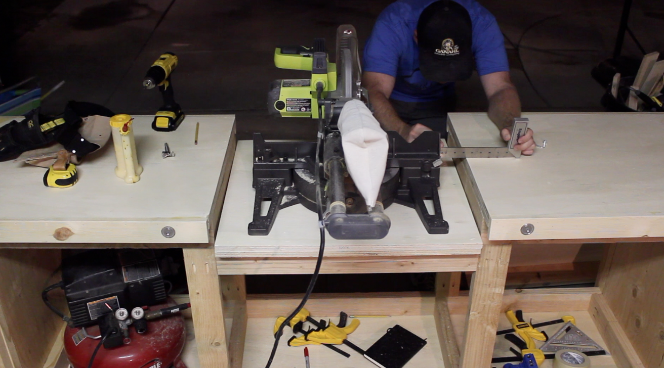 attaching the miter saw to the workbench insert