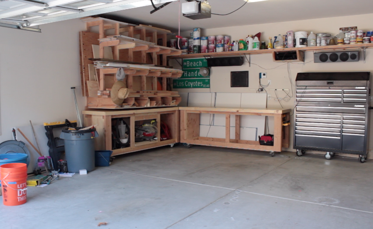 workbenches stored in the corner of the garage