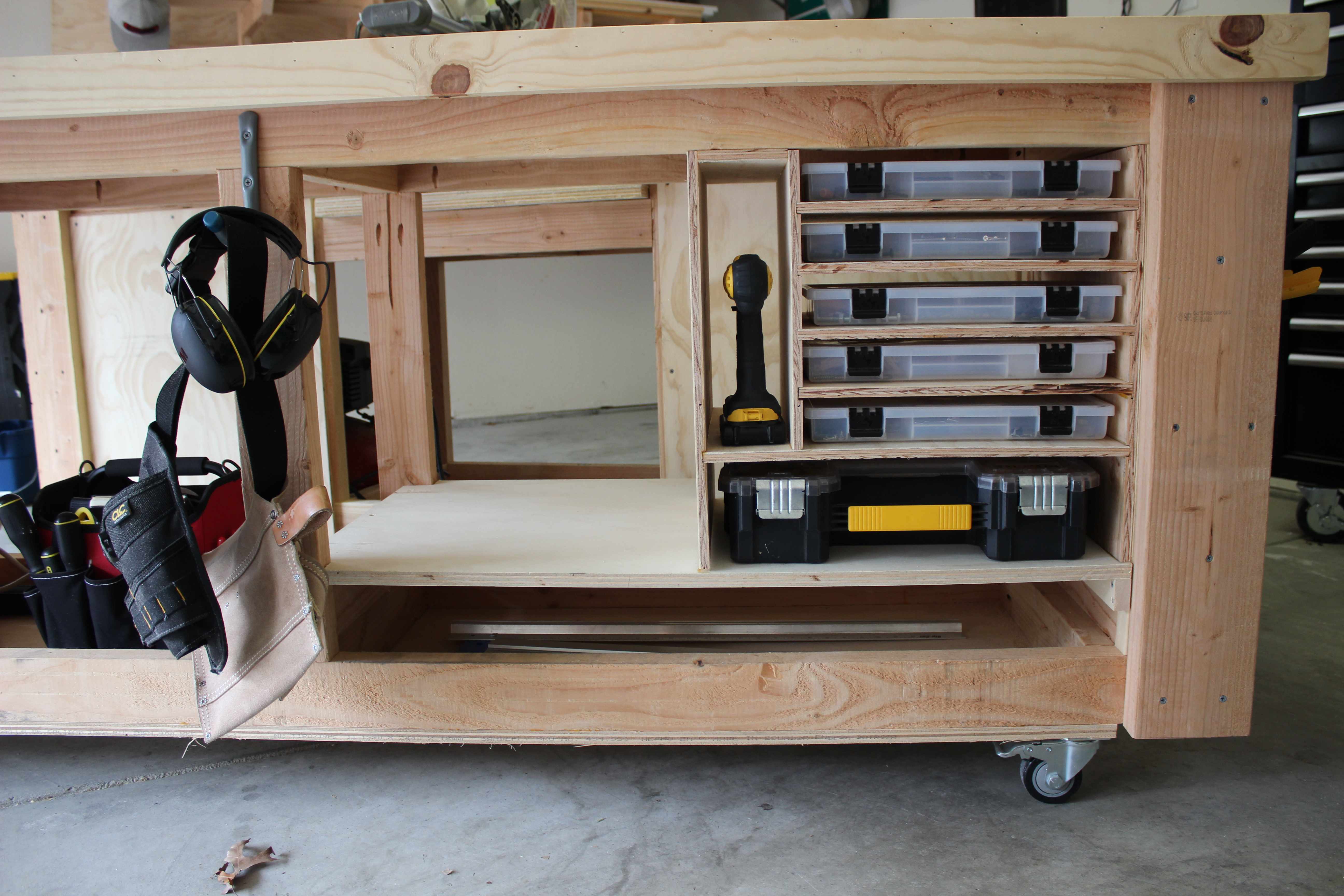 extra storage for screws and tools made out of plywood shelves