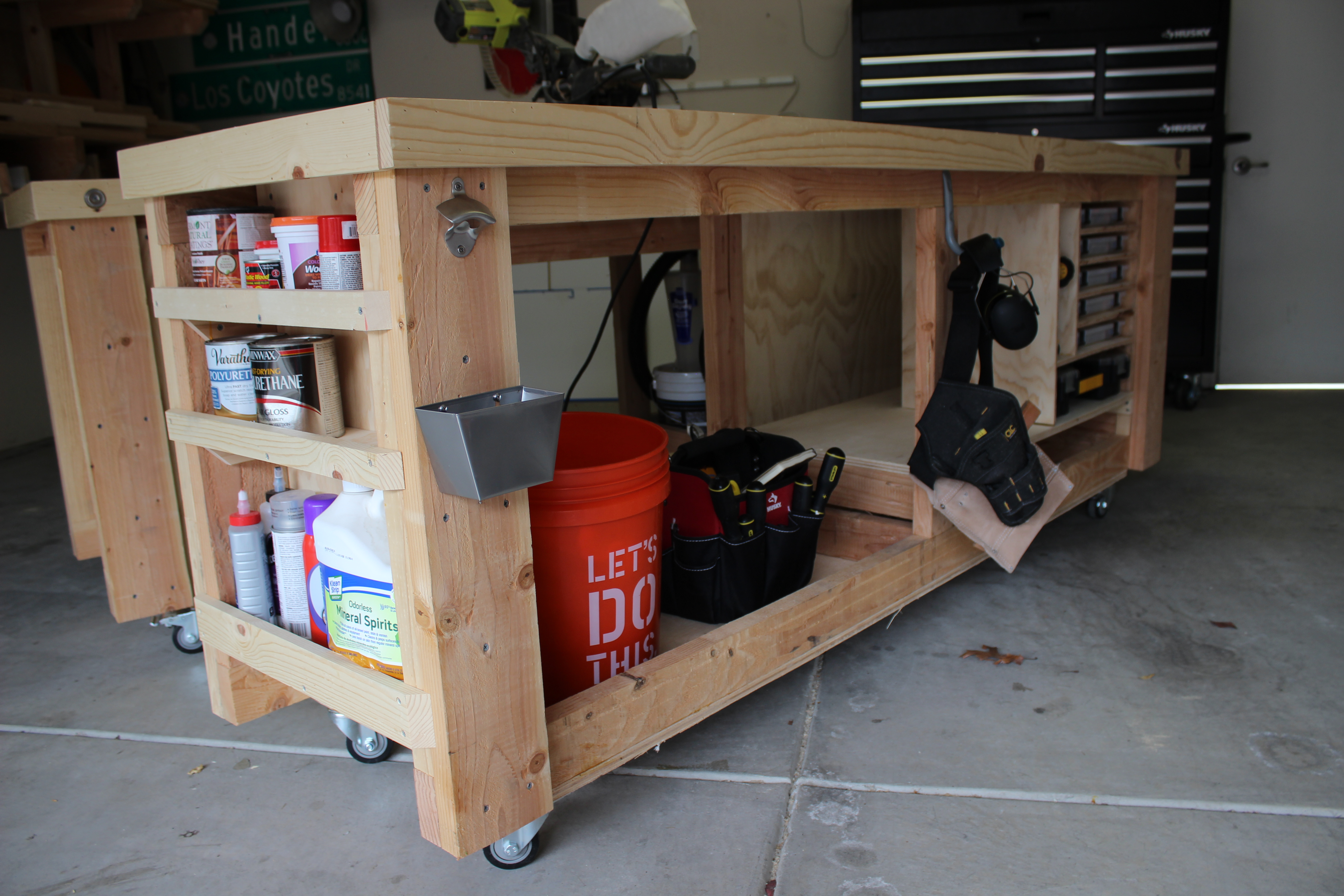 Side view of mobile workbench with shelves and storage