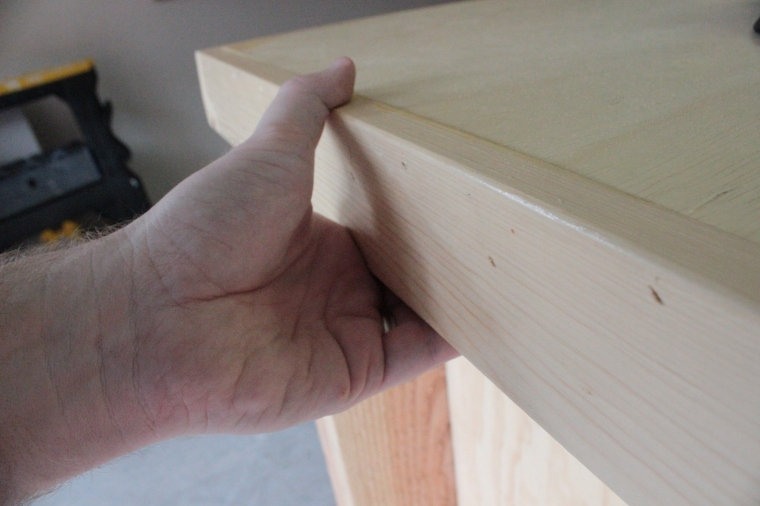 gripping the workbench edging