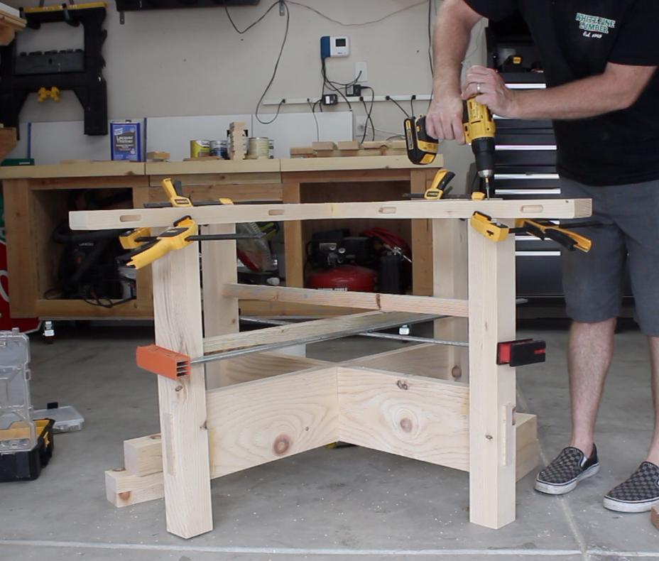 attaching the top stretcher to table base