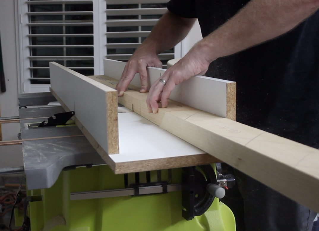 Using a table saw sled to cut slots for lap joints in table stretchers