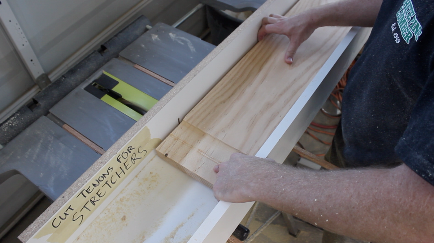using table saw sled to cut through tenon in table stretcher