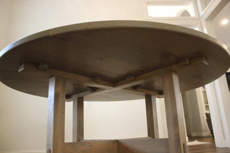 wide shot of underneath of pine dining table