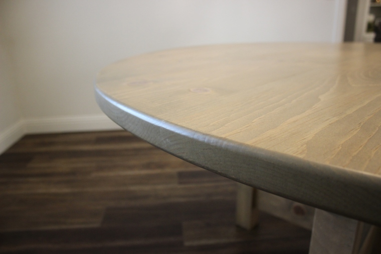 close-up of rounded edge of dining table