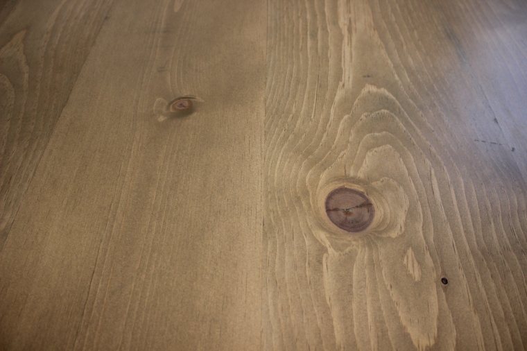 close-up of pine wood and stain on table top