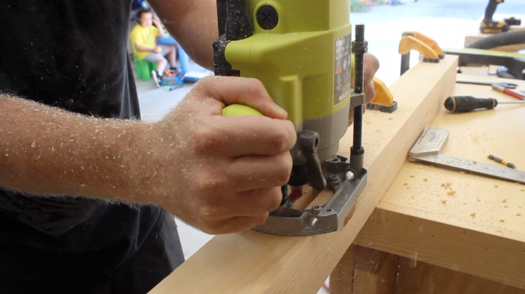 Using a plunge router to create a mortise in the table leg