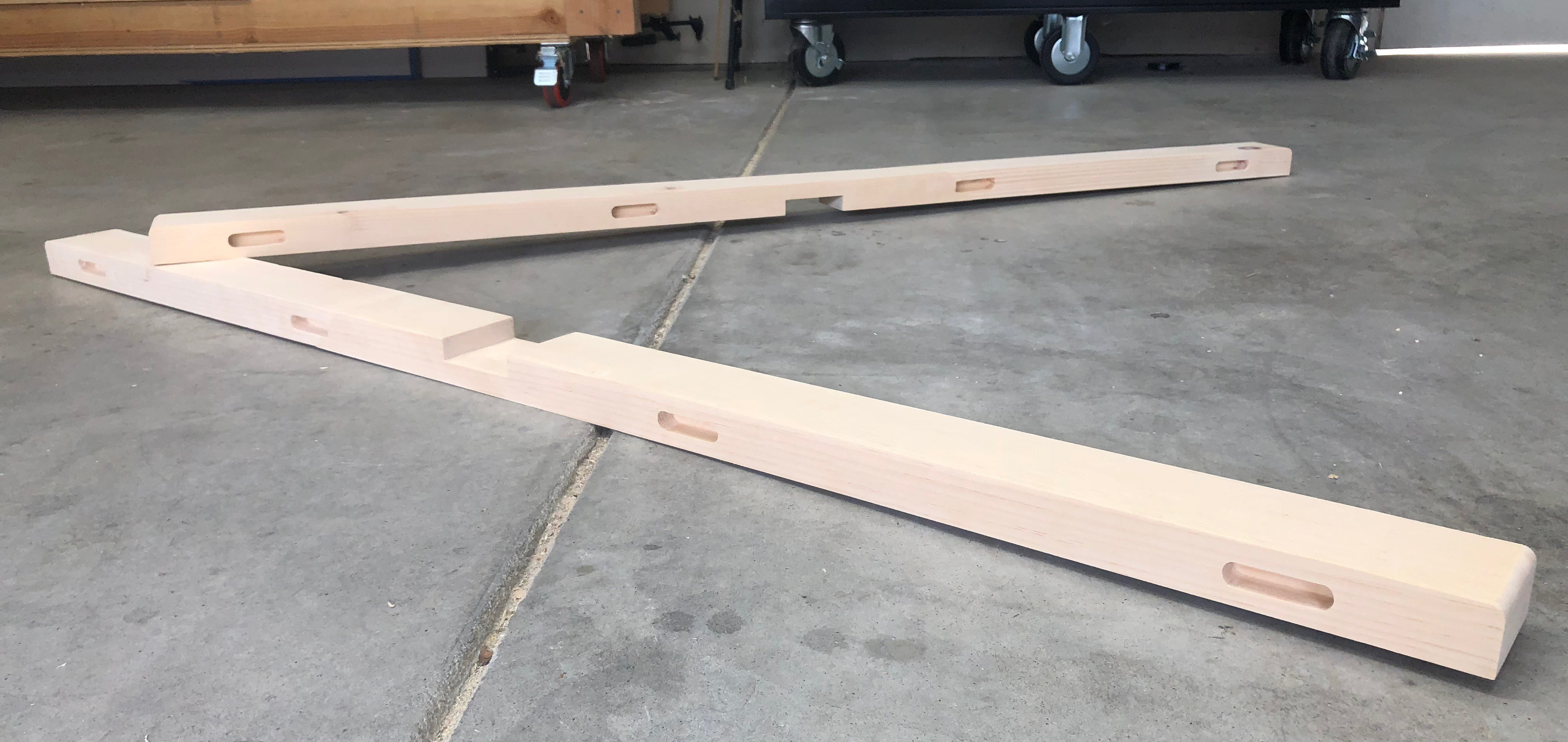 two top stretcher boards sitting on the garage floor